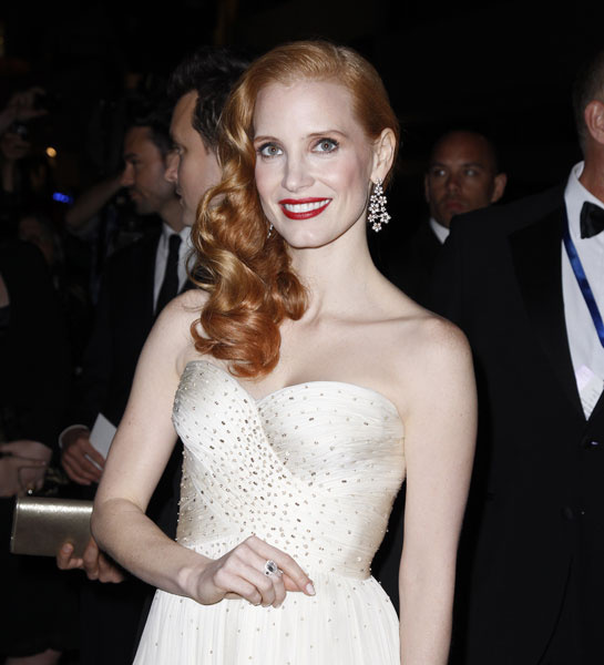 Jessica Chastain accessorized her Armani dress with pink and yellow gold diamond earrings by Chopard